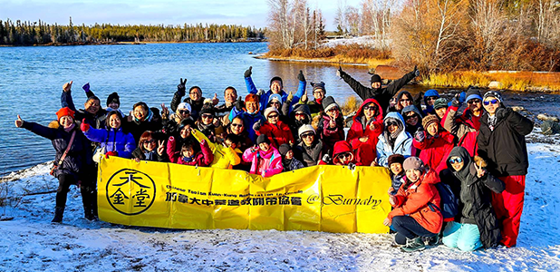 Group photo of association volunteers against snowy background